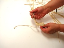 For Niqqi's Hawaiian hula skirt her mom makes a knot with the raffia over the cord.